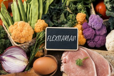 raw vegetables, eggs and meat and text flexitarian